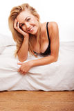 Sexy smiling blonde on her bed Stock Photo