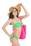 Sexy smiling brunette girl wearing green swimsuit and big hat Stock Photo