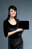 smiling brunette presents new touch pad devic stock images