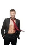 Sexy smiling businessman in red tie. Portrait of young caucasian sexy smiling man in black suit and red tie dressed over naked body Royalty Free Stock Images