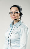 Sexy smiling call center operator portrait Royalty Free Stock Image