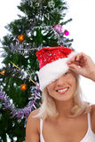Sexy smiling girl near christmas tree. Portrait of playful young blonde near christmas tree Royalty Free Stock Photos