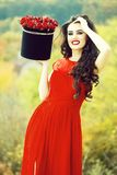 smiling girl with red roses royalty free stock photography