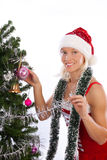 Sexy smiling santa near christmas tree Stock Photo