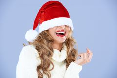 Free Sexy Smiling Woman Blinded By Red Santa Hat Royalty Free Stock Photo - 27142305