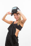 Sexy smiling woman in welder helmet Royalty Free Stock Photography