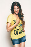Sexy smiling woman in yellow top. In studio Royalty Free Stock Images