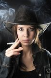 Sexy smoker cowgirl Royalty Free Stock Image