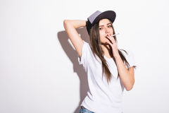 smoking beautiful woman in cap with cigar closeup studio shot Stock Image