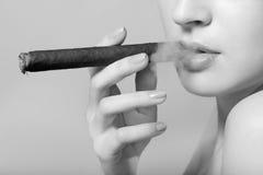 Sexy smoking beautiful woman cigar Stock Images