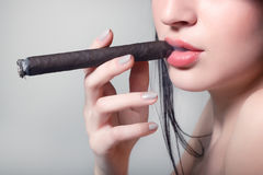 Sexy smoking beautiful woman cigar closeup Stock Photo