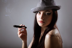 Sexy smoking beautiful woman cigar closeup Royalty Free Stock Photography