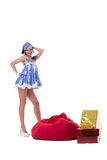 Sexy Snow Maiden posing with bag of gifts Royalty Free Stock Photography