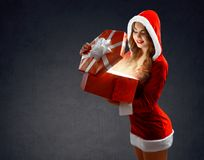 Sexy Snow Maiden in red suit holds a gt for New Tear 2018,2019 Stock Photo