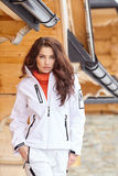 Sexy snowboarder woman  outdoors. Winter resort Royalty Free Stock Photo