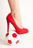 Sexy soccer. High heel shoe and soccer ball Stock Photography