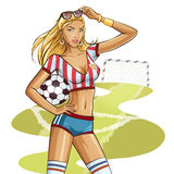 Sexy soccer player. Holding a ball Stock Images