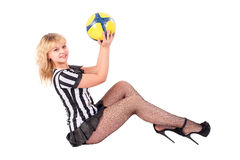 Sexy Soccer Referee plays with ball on floor Stock Photos