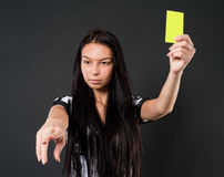 Sexy Soccer Referee with yellow card Royalty Free Stock Image