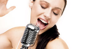 Sexy song. Sexy singer with retro microphone singing Stock Image
