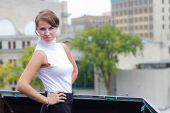 Sexy, sophisticated woman poses in urban city area downtown. A sexy, sophisticated woman poses in urban city area royalty free stock photos