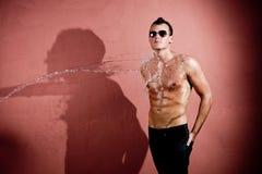 Sexy splash man Stock Images