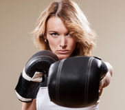 Sexy sportish woman  in boxing gloves Royalty Free Stock Image