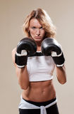 Sexy sportish woman  in boxing gloves Stock Photos