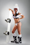 Sportswoman with snowboard. Over grey background, full body stock photo