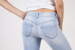 Sexy sporty ass in blue jeans Royalty Free Stock Images