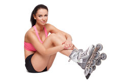 Sexy sporty brunette woman on roller blades Royalty Free Stock Photo
