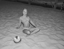 Sexy sporty girl volley ball on the sand Playground. black and white. Stock Images