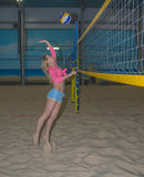 Sporty girl volley ball on the sand Playground. Volleyball courts, a sporty girl stock photos