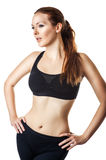 Sexy sporty woman. With slim stomach, hip and waist over a white background Royalty Free Stock Photos
