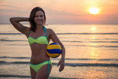 Sexy sporty woman in bikini with ball over sea background Royalty Free Stock Image