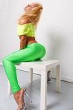 Sexy sporty woman. Sexy blond sporty woman in green leggings Stock Photography