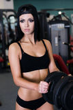 Sexy sporty woman doing power fitness exercise at sport gym. Beautiful girl working out in gym. Royalty Free Stock Image