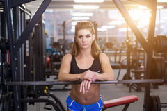 Sexy sporty woman doing power fitness exercise at sport gym. Beautiful girl working out in gym. Stock Photo