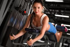Sexy sporty woman training in the gym Royalty Free Stock Photo