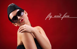 Sexy stewardess. Red background. fly and fun concept Stock Photo
