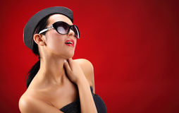 Sexy stewardess. Red background. fly and fun concept Stock Photos