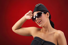 Sexy stewardess. Red background. fly and fun concept Royalty Free Stock Images