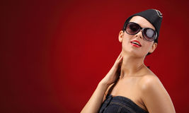 Sexy stewardess. Red background. fly and fun concept Royalty Free Stock Photos
