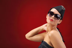 Sexy stewardess. Red background. fly and fun concept Stock Images