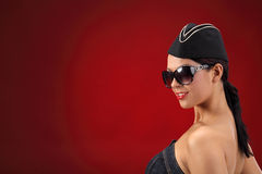 Sexy stewardess. Red background. fly and fun concept Royalty Free Stock Photography
