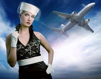 Sexy stewardess. And flying plane Royalty Free Stock Image