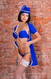 Sexy stewardess in blue uniform Royalty Free Stock Photos