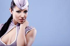 Sexy stewardess woman Stock Photography