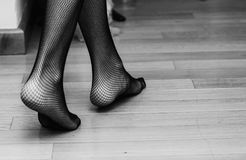 Sexy stockings. Unrecognisable model wearing fishnet stockings Royalty Free Stock Photo