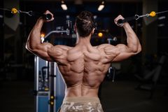 Strong bodybuilder athletic men pumping up muscles with dum. Strong bodybuilder athletic fitness man pumping up abs muscles workout bodybuilding concept royalty free stock photos